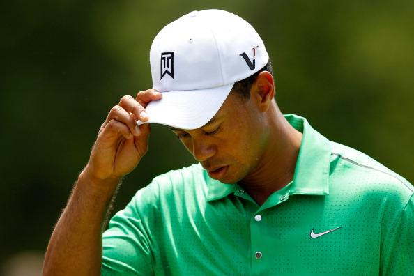 CHARLOTTE, NC - MAY 04:  Tiger Woods of the United States reacts after putting on the ninth green to finish his second round of the Wells Fargo Championship at the Quail Hollow Club on May 4, 2012 in Charlotte, North Carolina.  (Photo by Streeter Lecka/Getty Images)
