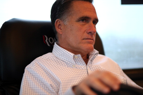 AVON LAKE, OH - OCTOBER 29:  Republican presidential candidate, former Massachusetts Gov. Mitt Romney sits on his campaign bus en route to a campaign rally at Avon Lake High School on October 29, 2012 in Avon Lake, Ohio. Romney canceled campaign events on October 29 and 30 due to Hurricane Sandy.  (Photo by Justin Sullivan/Getty Images)