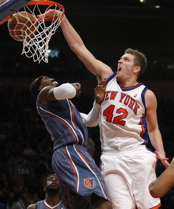 New York Knicks center David Lee (42) dunks over Charlotte Bobcats forward Gerald Wallace in the second quarter of an NBA basketball game at Madison Square Garden in New York, Thursday, Jan. 7, 2010.  (AP Photo/Kathy Willens)