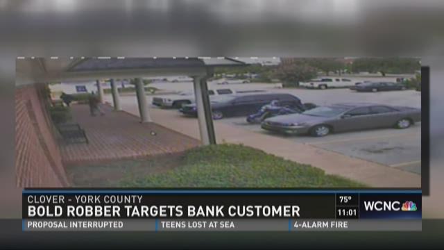 Bold robber targets bank customer