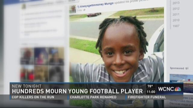 Hundreds mourn young football player