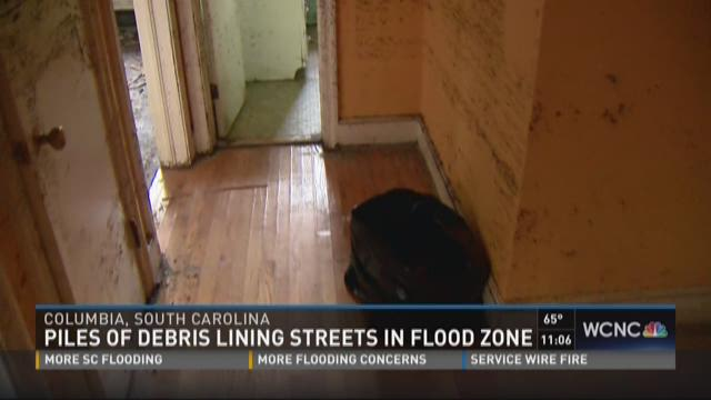 Piles of debris lining streets after flooding in Columbia